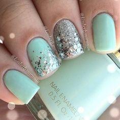 Sea foam green nails with silver confetti glitter and accent silver glitter nail.