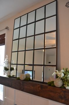 Knock off of Pottery Barn Eagan mirror -- a different DIY tutorial at A Creative Beginning. -- maybe add that distressed look?