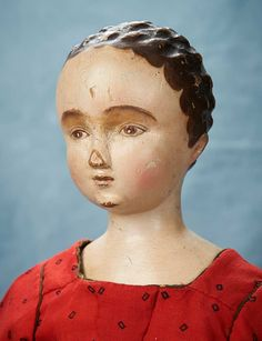 Compelling Early Carved Wooden Doll