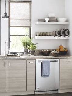 Gray is the new neutral. This chic kitchen features Weston cabinets in Persian Gray and quartz countertops in Cove. Both are from Martha Stewart Living™, available exclusively at The Home Depot.