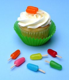 Little popsicle cupcake toppers were made from flat toothpicks pushed into Mike and Ike candies.