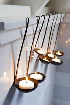 What a great way to display votives. The handles of the ladles are flexible so the votive may sit flat. xo