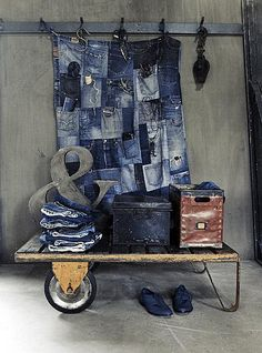 Old denim jeans pockets stitched together to make wall storage ♥♥♥