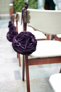 purple pom on chair
