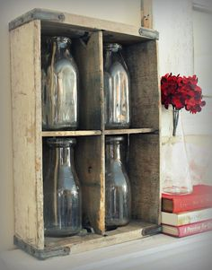 vintage glass milk jugs in old crate...I neeeeeeed to do this with all of those glass milk jugs I have