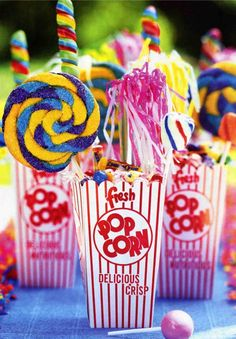 Easy popcorn container, cute lolipops  a few more colorful candies. The perfect circus favors.