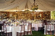 Gorgeous set up for an outdoor wedding. Simple colors, rustic and classy table setting and chairs