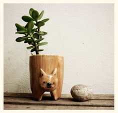 Brown cat pot. $50.00, via Etsy.