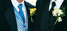 Groomsmen: cornflower blue vests and ties to match bridesmaid dresses with yellow freesia boutonnieres.   Groom: Black vest and tie with white boutonniere