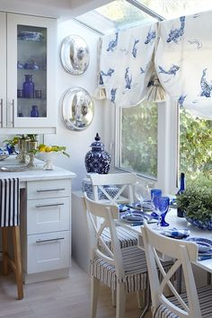 Love cobalt and white decor. Billowy balloon shades, coordinating slip covers on kitchen table chairs and the back of the desk chair I The Little Corner