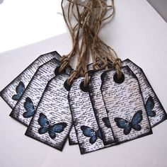 blue butterfly tags by shintashop etsy store. I want to make these in these colors!