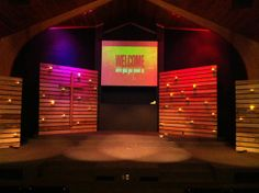 I like the cross on the pallet wall with the candles.
