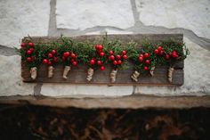 Berries boutonnieres for rustic winter wedding