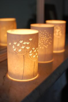 de Hannah Nunn lights, lantern, seed, paper lamps, candle holders, candles, paper design, candle jars, candl light
