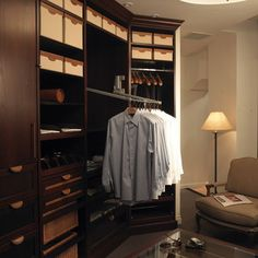 Valet rods - These handy racks pull down with ease, letting you take advantage of the high space in your closet.     by Lisa Adams, LA Closet Design