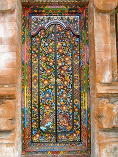 Jaw-dropping, carved and colorful door in Indonesia: Photo by Corinna Carlson