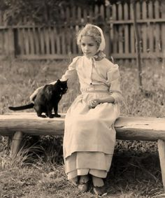 1800's girl with cat.