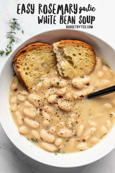 This incredibly easy Rosemary Garlic White Bean Soup takes only eight simple ingredients to deliver a bowl full of rich, bold flavor. BudgetBytes.com #soup #beans