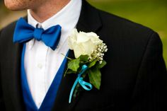 groom's blue bow tie and white rose boutonniere