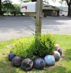 bowl ball, yard art, ball garden, garden edging, garden structures, garden beds, ball yard, yard crafts, bowling ball