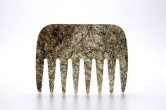 A comb made of repurposed human hair.