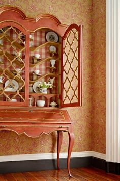 Mondeville wallcovering in color Red and Biron Check in color Cranberry from the Charles Faudree for Stroheim collection.