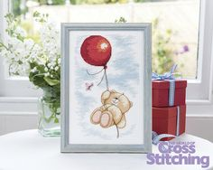 Cross stitch pattern – Forever Friends bear. Flying high! This project exclusive, from the Anchor design studio, will be a great make for any occasion. Find it in the new issue 219 of The World of Cross Stitching magazine