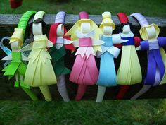 Easy but on Etsy. Adorable princess party favor.  DIY hair bow gift for birthday girl. Figure of Disney princess made out of ribbon & attached to headband. Princess party theme must have.
