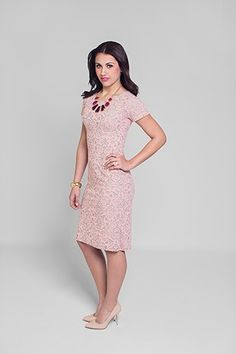 The Paisley Dress is a trendy and modest, knee length dress with short sleeves and a unique burnout of pink fabric in damask design. Washable.