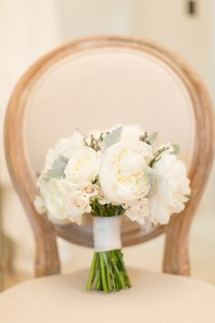 White peony and white rose bouquet: http://www.stylemepretty.com/little-black-book-blog/2014/09/25/elegant-chicago-wedding-at-fultons-on-the-river/ | Photography: Cristina G - http://cristinagphoto.com/