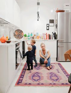 Hanna Wessman's kid friendly kitchen complete with comfy rug via Hanna's Room
