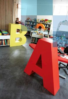 Taastrup Public Library - great design for children's section.  What if letters functioned as seating?