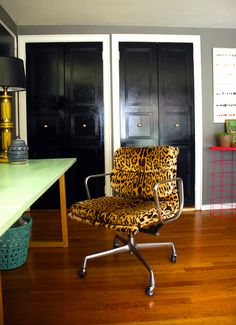 Little Green Notebook leopardo Eames chairs
