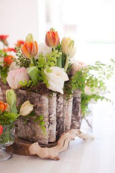 tulip arrangement in a vase made of wood