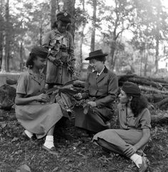The first Girl Scout, Daisy Gordon Lawrence, with Girl Scouts in 1948.  (Daisy's aunt, Juliette Gordon Low, started Girl Scouts on March 12, 1912.)