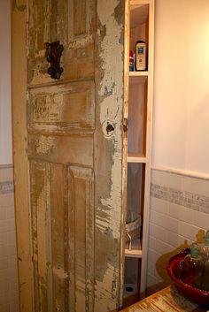 repurpose old door- corner cabinet