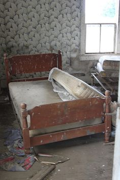 bed inside an old Abandoned House