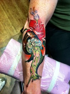 Snail and Rose tattoo by Henry Lewis
