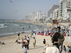 Tel Aviv, Israel, is one of the few metropolitan cities in the world that has beautiful beaches. At Gordon Beach, people sunbathe, play matkot (beach tennis), and swim — just steps from the bustling city.