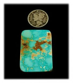 Large Rectangular Blue Royston Cabochon. This is a gorgeous powder blue with golden brown matrix and water webbing - a fantastic gemstone at $160.00. Find this amazing collectors Turquoise gemstone and more by following this link.