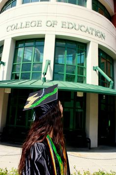 Mortar board with #USF green and gold Bull Horns logo.
