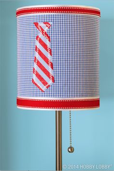 Suit up a silver buffet lamp with sweet blue gingham fabric, smart grosgrain ribbon, and a ready-to-go necktie appliqué (available in the Wearables Department).