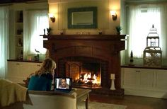 Fireplace with cabinetry on each side.