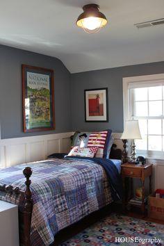 nautical vintage boys bedroom.  blue/gray walls, plaid quilt, board and batten walls