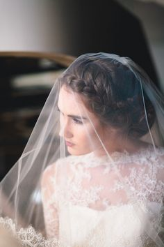 braided up do topped off with a whisper soft veil