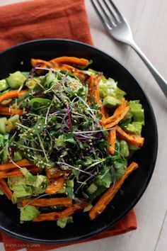 greens, sprouts, and sweet potato salad