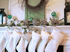Fresh green, blue and white Christmas mantel. Lace embellishments on Pottery Barn stockings.