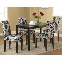 @Overstock.com - Update your dining room with this black and white five-piece dining set. With its solid wood frame and sophisticated, printed plush upholstery, this dining set will give your home a comfortable and stylish place to share a meal with friends and family.http://www.overstock.com/Home-Garden/Parson-Black-and-Silver-5-Piece-Dining-Table-and-Chairs-Set/6467779/product.html?CID=214117 $314.09