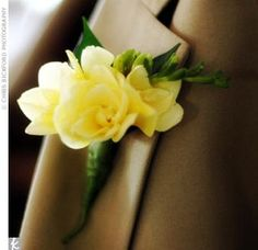 To accent his khaki-colored suit, the groom wore a fragrant boutonniere of freesia.