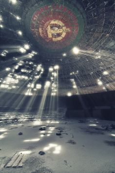 No this isn't the mothership... this is the Buzludzha Monument, abandoned saucer-shaped Communist party Headquarters on a Bulgarian Mountaintop...